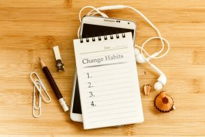 "notebook with a list named ""change habits"""