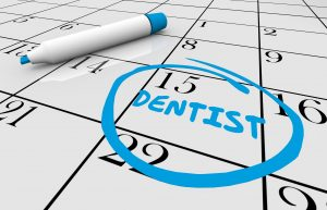 Appointment with dentist circled on calendar.